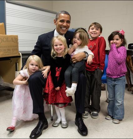 Emilie Parker standing with President Barack Obama...