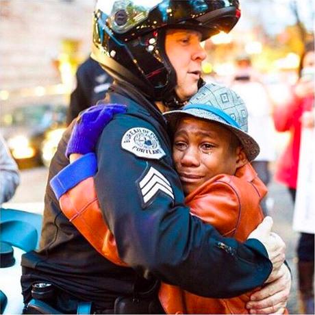 Portland cop Bret Barnum hugging Devonte Hart.